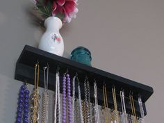 DIY necklace organizer idea (also, @Sheri Shibley and @Evan Sheline doesn't that little blue piece of glass look like the one I just mailed home)