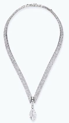 AN EXQUISITE ART DECO DIAMOND NECKLACE   Designed as a marquise-shaped diamond pendant weighing 10.02 carats suspended from a circular and baguette-cut top to the V-shaped pavé-set diamond necklace, mounted in platinum, circa 1920, 43.0 cm long