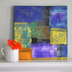 Small sheets of colored tissue paper are placed on top of the different textures pictured. Printing ink is rolled over the tissue using the brayer and capturing the image of the texture. Spray glue attaches the sheets of tissue to a stretched canvas. Voila! Fun and pretty.