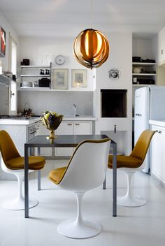 saarinen chairs / helenio barbetta