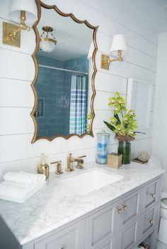 beach house bathroom with shiplap wall
