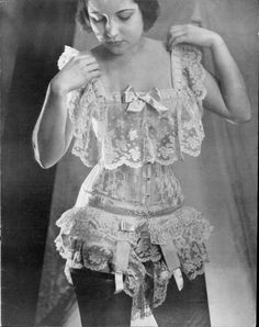 Over the top ruffles and lace vintage lingerie ensemble.  Stark contrast of black stockings.