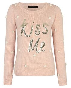 Feeling cheeky under the mistletoe? This pretty pink Christmas Jumper is exactly what you need!