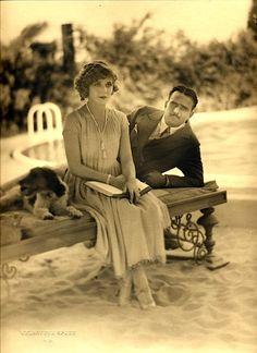 Mary Pickford and Douglas Fairbanks, circa 1920.  Great dress