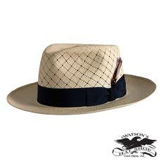 """The Cris Cross got it's name because of the pattern that has been hand woven by master weavers. This hat has superior venting and great sun protection on top of the hat and throughout the brim. Shown: Grade 16 Color: Semi-bleach Crown: C-Crown Fedora Brim: 2 5/8"""" inches Ribbon: 16' Ligne Navy Bow: Double Fold and Keeper: Classico"""