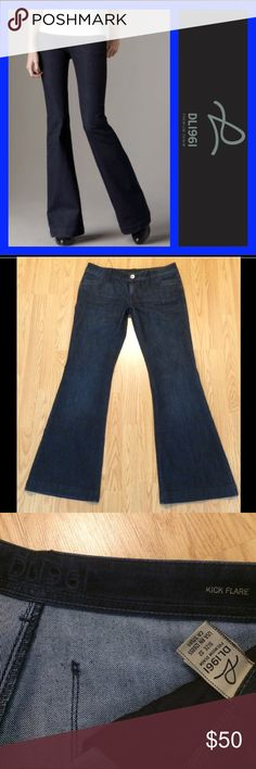 """DL1961: Roxy kick flare jeans - size 32 DL1961 Roxy kick flare jeans with a 33.25"""" inseam, 8.5"""" rise and 24"""" leg opening.. They measure 17"""" across the top of the waist when laying flat.. 73% cotton and 27% polyester.. There is one rhinestone missing on the right pocket (see last pic - bottom left).. Otherwise in EXCELLENT condition!!! DL1961 Jeans Flare & Wide Leg"""