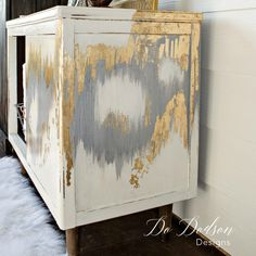 Mid century modern cabinet makeover with an artistic flare. I added metallic gray and gold leaf to create a one of a kind piece. Rustic modern glam!