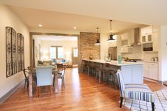 Masters of Flip, Kitchen and Dining Area. Love the character, atmosphere, brick wall.