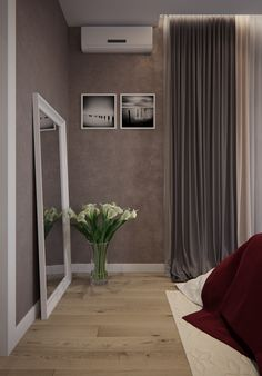 Interior design of a light bedroom with a podium bed and a red veil. Дизайн интерьера светлой спальни с кроватью подиумом и красным покрывалом.