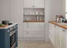 Hartside ultra smooth painted shaker style kitchen in Porcelain sink unit, Light Grey tall cupboard and Dark Blue island – First Impressions