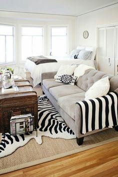 Love the zebra hide on top of the jute rug