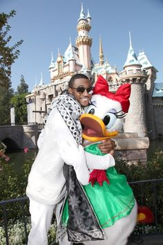 "Trey Songz shows Daisy Duck lots of love during a taping of the ""Disney Parks Frozen Christmas Celebration"" on Nov. 9 in Anaheim, Calif."