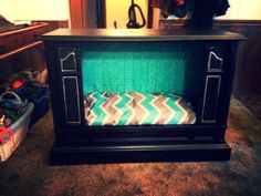 Upcycled console tv turned dog bed!! We have like 4 of these tvs in storage. deff doing!