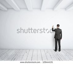 businessman drawing on white wall