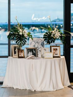 Chic and Modern Dockmaster Building Wedding - United With Love Alexandra Friendly Photography Welcome Table with Family Wedding Photos and Tropical Centerpieces Modern Wedding Centerpieces, Tropical Centerpieces, Wedding Flower Arrangements, Flower Centerpieces, Photo Centerpieces, Quinceanera Centerpieces, Centerpiece Wedding, Centerpiece Ideas, Wedding Photo Table