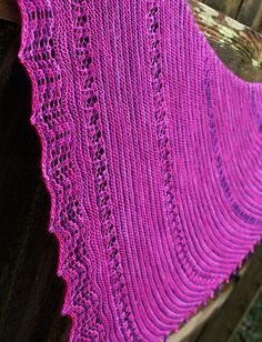Caprice is worked from tip to the lace edging. Simple garter stitch stripes are blended with crossed stitches and simple lace to create a shawl that's fun to knit and wear.