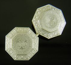 Beautifully engraved platinum top cufflinks decorated with scroll and floral designs.  The octagonal shape is highlighted with elegant Art Deco borders.  Crafted in platinum and 14kt gold,  circa 1920.  http://www.jewelryexpert.com/catalog/Platinum-on-Gold-Octagonal-Cufflinks-J9333.htm
