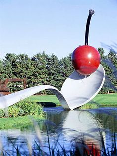 Claes Oldenburg and Coosje van Bruggen's Spoonbridge and Cherry @ Walker Art Center and Minneapolis Sculpture Garden.    Check out 14 Top Attractions in the Twin Cities -> http://www.midwestliving.com/travel/destination/minnesota/twin-cities-attractions/#