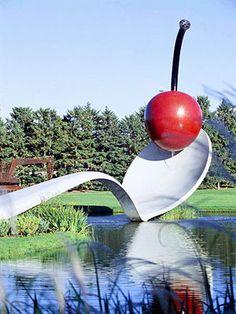 Claes Oldenburg and Coosje van Bruggen's Spoonbridge and Cherry @ Walker Art Center and Minneapolis Sculpture Garden.    Check out 14 Top Attractions in the Twin Cities -> http://www.midwestliving.com/travel/destination/minnesota/twin-cities-attractions/#