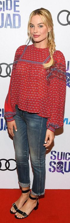 Who made Margot Robbie's red print top, black sandals, and jeans?