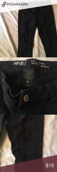 Ripped black skinny jeans Target brand skinny jeans! These have been loved for a long time with minimal show of wear, make an offer! Mossimo Supply Co Jeans Skinny