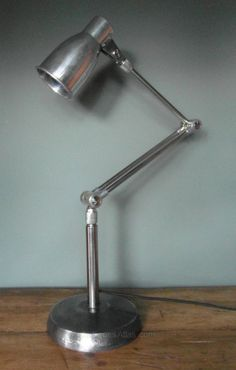 Kumewa, Switzerland, anglepoise-style lamp Model No. E-001, stated to be from 1940s. Cast Iron base, brass and aluminum fittings.
