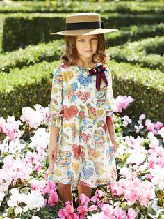 A printed dress with grosgrain  look from the Gucci Children's Spring Summer 2017 collection.