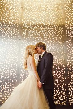 The dress! The backdrop! swoon!  Couple Kissing The Nichols | photography by http://jnicholsphoto.com/