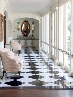 love the black and white floors with the pink chairs and gorgeous windows!
