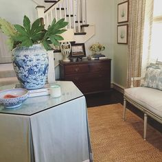 Pretty foyer entry: Soft colors, skirted table, lovely painted bench - Amy Berry