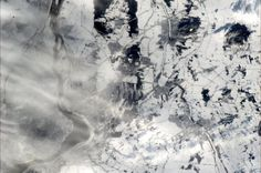 Montreal South Shore, in snow (and a trace of cloud) - how it looked today from ISS, 30 Dec at 12:40.