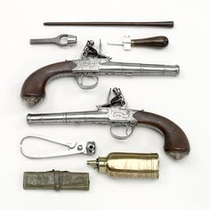 "1782-1798. British Flintlock pistols with accessories at the National Maritime Museum, London - From the curators' comments: ""Pair of cannon barrel flintlock pistols said to have been given to Captain Thomas Masterman Hardy 1769-1839 by Admiral Sir Thomas Troubridge 1758-1807."""