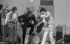 Guitarist Pete Townshend helps host Tom Smothers destroy his acoustic guitar as singer Roger Daltrey looks on, following British rock group The Who's performance on 'The Smothers Brothers Comedy Hour,' September 15, 1967.