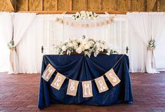 Navy Blue Wedding Reception Bride and Groom Sweetheart Table with Whie Flowers and Burlpal Banner | Rustic Tampa Bay Wedding Venue Cross Creek Ranch