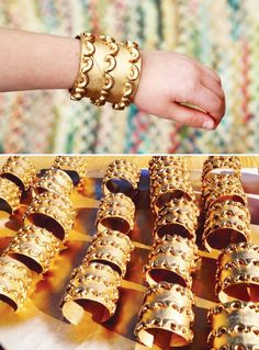 Gold Egyptian Cuff Bracelets - Rather than macaroni, I would allow children to stick the peel and stick gems to the cuff.