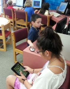 Denise, Jose and other kids are playing and learning today!