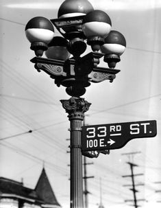 This is an interesting facet of life during WWII that I've never seen before. This five-bulb streetlight at the corner of Main and 33rd Streets, Los Angeles (near the USC campus) has all five of its bulbs blacked-out on top. With Pearl Harbor still fresh in the minds of Angelenos, the city would have been on dim-out.