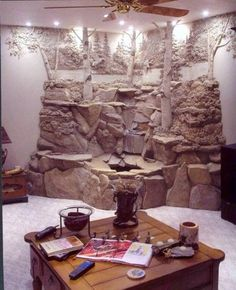 Water flows from a running waterfall. This waterfall was constructed from flagstone, lightweight concrete, and gypsum plaster. Plaster Sculpture, Plaster Art, Plaster Walls, Wall Sculptures, Indoor Waterfall, 3d Wall Art, Interior Decorating, Interior Design, Faux Stone
