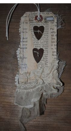 This is a handmade tag that I designed. I have incorporated vintage papers, lace and metal hearts to make up this tag.