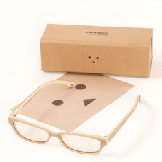 Danboard Computer Glasses From Tokyo Otaku Mode comes original computer glasses modeled after the popular character from Yotsuba&!, Danboard! The color of the frames is themed after that of a cardboard box, the material Danboard is made of, and comes in a relaxed beige. Differing shades are also used on the exterior and interior, giving a unique look from every angle.  Is the Danboard theme just reflected in the frame color?Not at all, the temple tips even have Danboard's cute face on them.