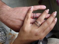 "Wedding Ring Tattoos Hebrew Script - Forget Rings - These Wedding Tattoos Are Way Cooler - Photos - This tattoo, written in Hebrew, says, ""I am my beloved's and my beloved is mine.""Image here. Tattoo Ringe, Ring Tattoo Designs, Wedding Band Tattoo, Tattooed Wedding, Paar Tattoos, Ring Finger Tattoos, Tattoo Zeichnungen, Tattoo Spirit, Custom Wedding Rings"