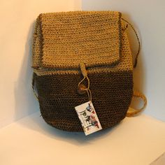 This backpack is made from a fibrous material which is similar to jute and referred to as peser. The packs are highly durable and will last for years to come. This variety has a distinctive green base and top flap with a drawstring and button closure and an internal zipped compartment. This size would be a good choice for your daily office or school requirements. The pack's colour will vary slightly from item to item.
