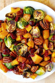 Roasted Brussels Sprouts, Cinnamon Butternut Squash, Pecans, and Cranberries. The perfect holiday side dish. @juliasalbum