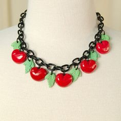 Retro Cherry Charm Necklace:Calling all you cherry lovers and lovers of vintage style jewelry, this retro cherry charm necklace is just what you need! This necklace features hand cast resin cherries and leaf pendants on a black enamel metal chain. The necklace measures 17.5 inches and closes with a silver metal clasp. The cherry and leaf pendant's measure approximately 3/4 inches. *Please note... $28.00
