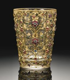 A MUGHAL GEM-SET ROCK CRYSTAL CUP, INDIA, CIRCA 18TH CENTURY the rock crystal carved in the form of a cup, set with gold floral tendrils highlighted with rubies, emerald and diamonds, in custom velvet box
