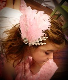 Feather hair clip with rhinestone and pearl accent by SonBel, $11.00