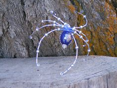 Blue filagree spider christmas ornament handmade. $20.00, via Etsy.  This I found is very unique and I would say, again, low priced. I would easily encourage at least doubling the price. $40 at least.