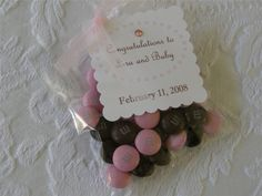 "Pink or Blue M & M favors with a cute little ""It's a Girl"" or ""It's a Boy"" paper tag"