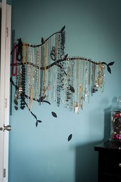 Hang jewelry from vinyl tree branch decal.