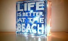 Life is better at the beach, glass block, vinyl letters from my cricut and alcohol inks over etching cream to give the string of lights a soft touch.
